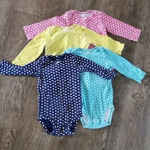 2/$15 Carter's baby girl onesie bundle size 12 M .